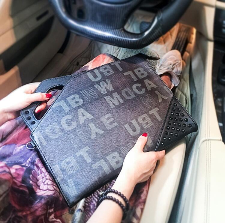 Factory wholesale brand men handbag street trend letters printed men and women wrist bag personality rivet punk hand bag fashion leather bag