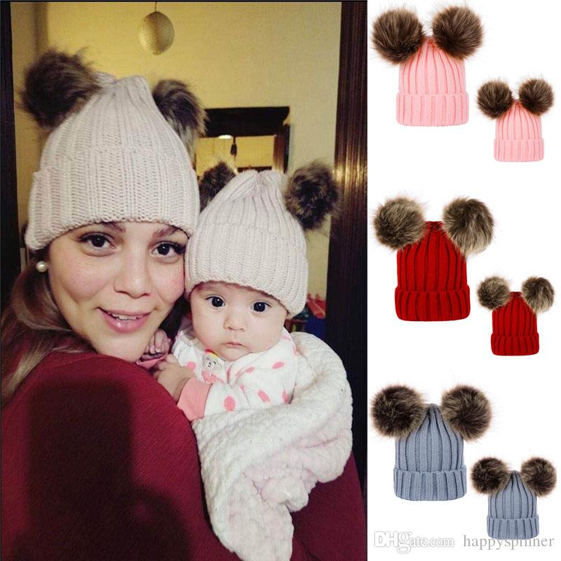 y de otoño de los niños y las mujeres modelos de invierno de punto de lana Sombreros doble casquillo de la cabeza del pelo de la bola casquillo al aire libre