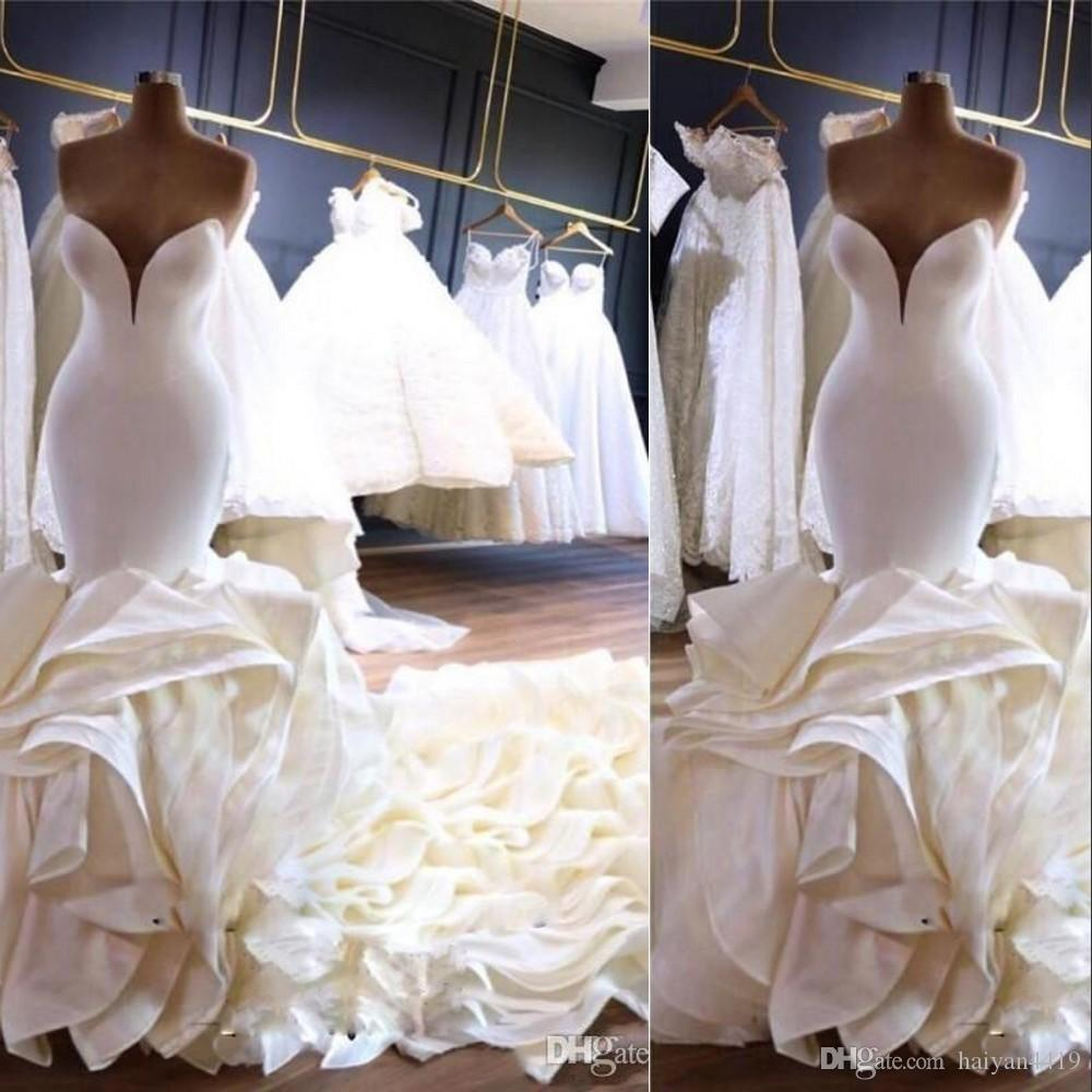 2020 New Sexy Luxurious Mermaid Wedding Dresses Sweetheart Sleeveless Backless Satin Tiered Ruffle Cathedral Train Formal Bridal Gowns