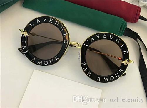 0113S Hombres Mujeres diseñador Gafas de sol Moda Gafas redondas Protección UV Lente Revestimiento Espejo Lente sin marco Color Plateado Viene con la caja 01