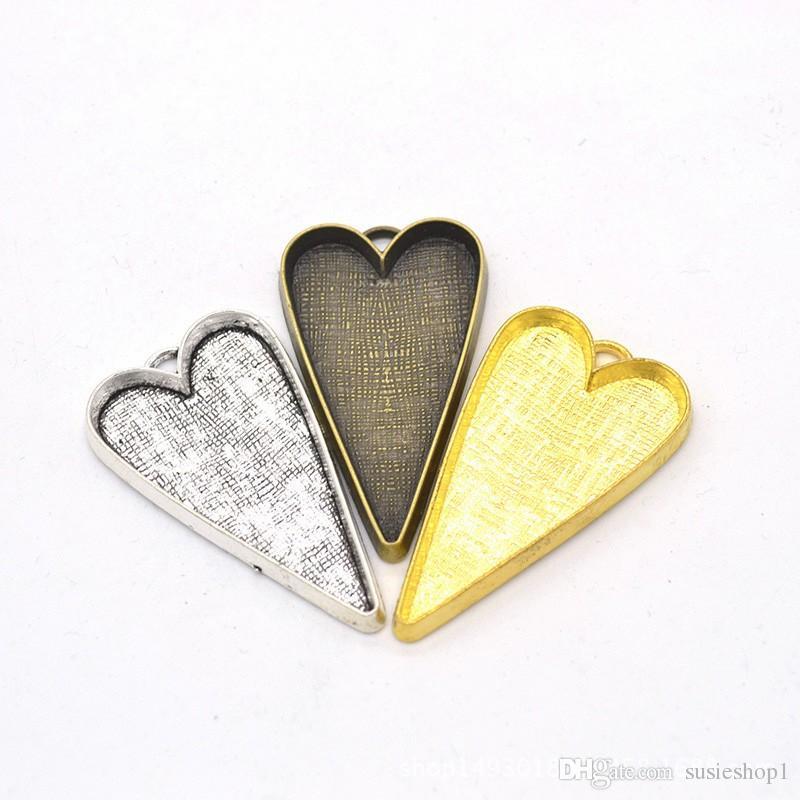 100pcs / lot métal pendentif coeur plateaux réglage de base de coeur blanc pour 50 * 26mm cabochons argent antique, bronze, couleurs d'or