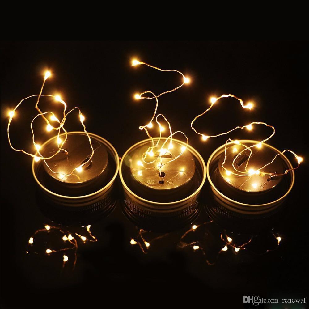 Solar Powered LED Mason Jars Light Up Tapa 10 LED String Fairy Star Lights Tapas de plata para Mason Glass Jars Luces de jardín de Navidad
