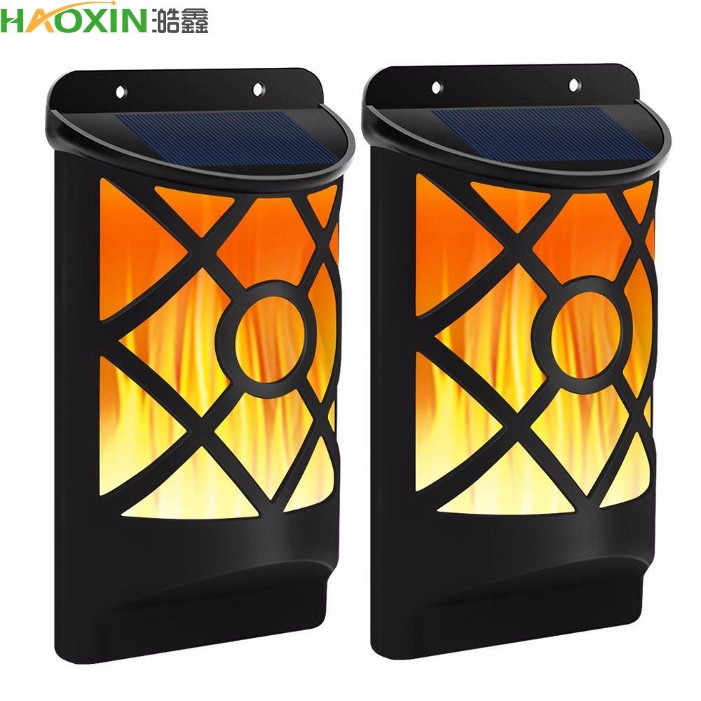 Haoxin Solar LED Luz al aire libre solar Sentido 66LEDs llama vacilante antorcha de la lámpara a prueba de agua al aire libre de las luces de pared para la decoración del jardín