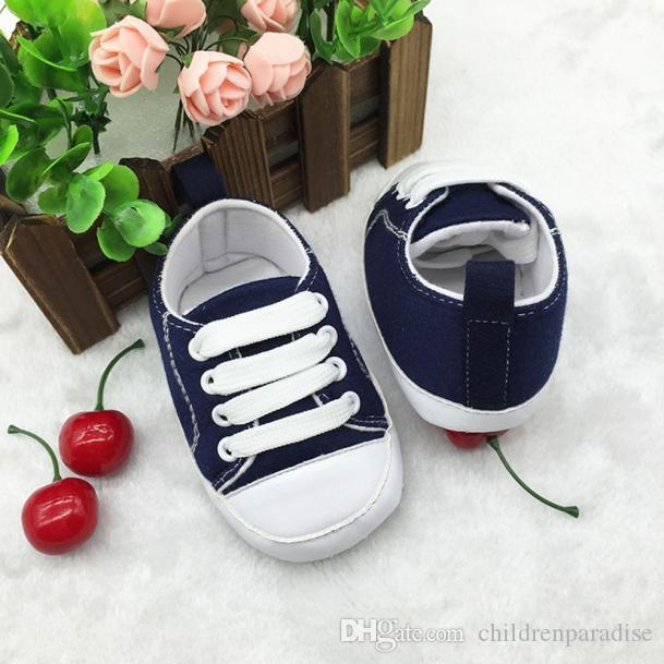 Großhandel Babyschuhe Mädchen Junge Weiche Anti Rutsch Segeltuchschuhe Baby Großes Geschenk Lace Up Composite Sohle Bunte Schuhe Von Childrenparadise,