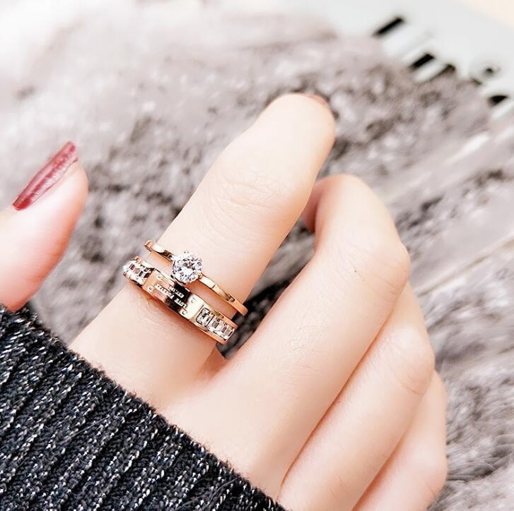 مجوهرات عيد الحب سيدة التيتانيوم الصلب خاتم مزدوج الرجعية مع 18 كيلو روز الزركون الكورية المشتركة الدائري