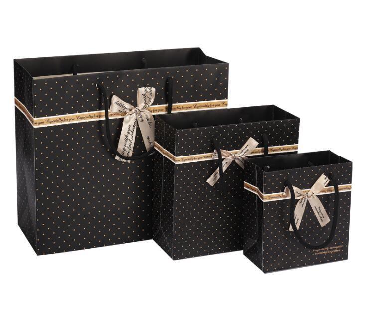 Black Stripes bow polka dots Borsa di carta regalo shopping shopping compleanno di compleanno Borsa da viaggio Borsa regalo