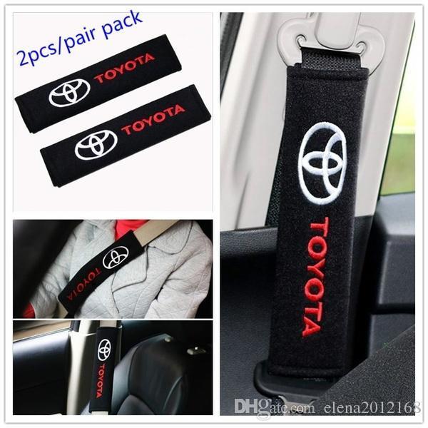 2PCS / مجموعة وسادات الأزياء العالمي القطن حزام الأمان الكتف يغطي الشعارات لإكسسوارات السيارات تويوتا الشارات سيارة-تصفيف تناسب جميع السيارات