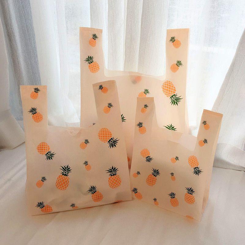 50pcs Suministros piña plástico lindo fiesta de cumpleaños bolsa de regalo bolsa de plástico anaranjado claro Para llevar bolsa de embalaje de los alimentos