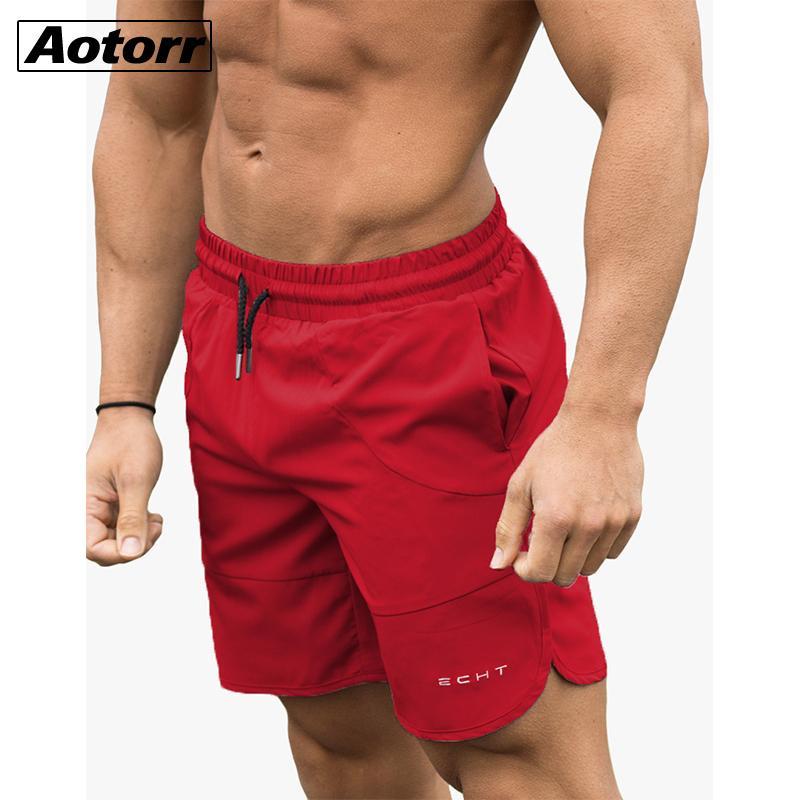 Ejecución de entrenamiento Pantalones cortos de los hombres de secado rápido culturismo gimnasia pantalones cortos de spandex Deportes Correr 2020 del bolsillo de Formación pantalón corto de tenis CX200701