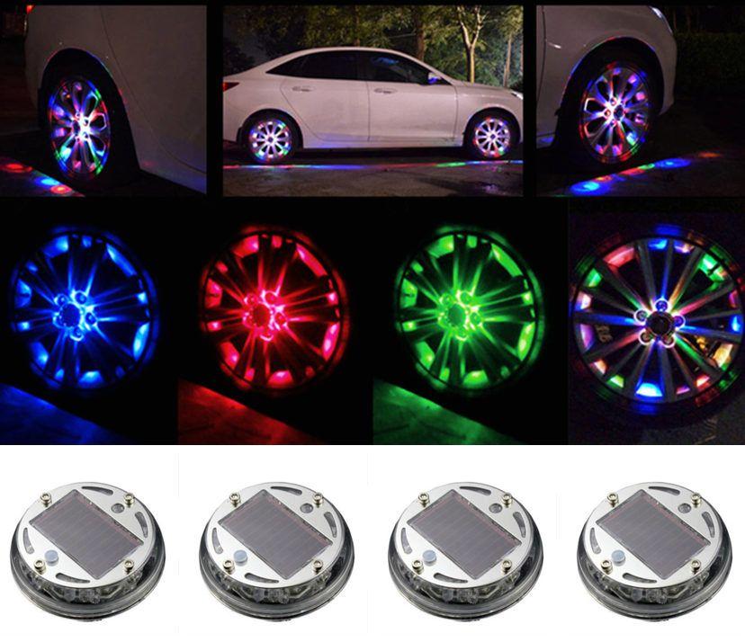 La luce 4pcs Car RGB rotella 4 Modalità 12 LED RGB auto decorazione Auto Solar Energy Flash gomma della rotella della luce della lampada Car Cover Styling