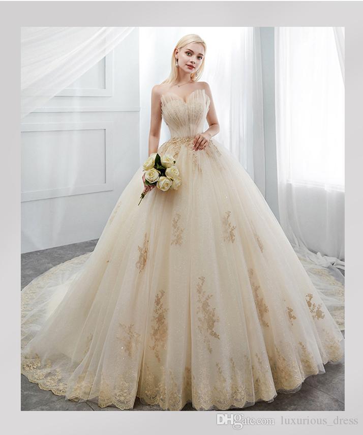 Beaded Sweetheart Tulle Ball Gown Wedding Dress 2019 Champagne Ivory Floor Length Bridal Gowns New Wedding Dresses Vestidos De Novia