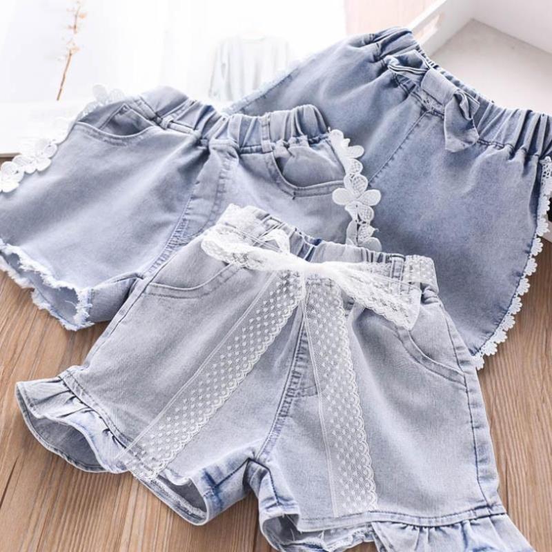 4T-12T niños al por mayor dril de algodón de 2020 muchachas del verano atractivo de la manera de costura del cordón caliente pantalones vaqueros ocasionales coreanos cortos L237