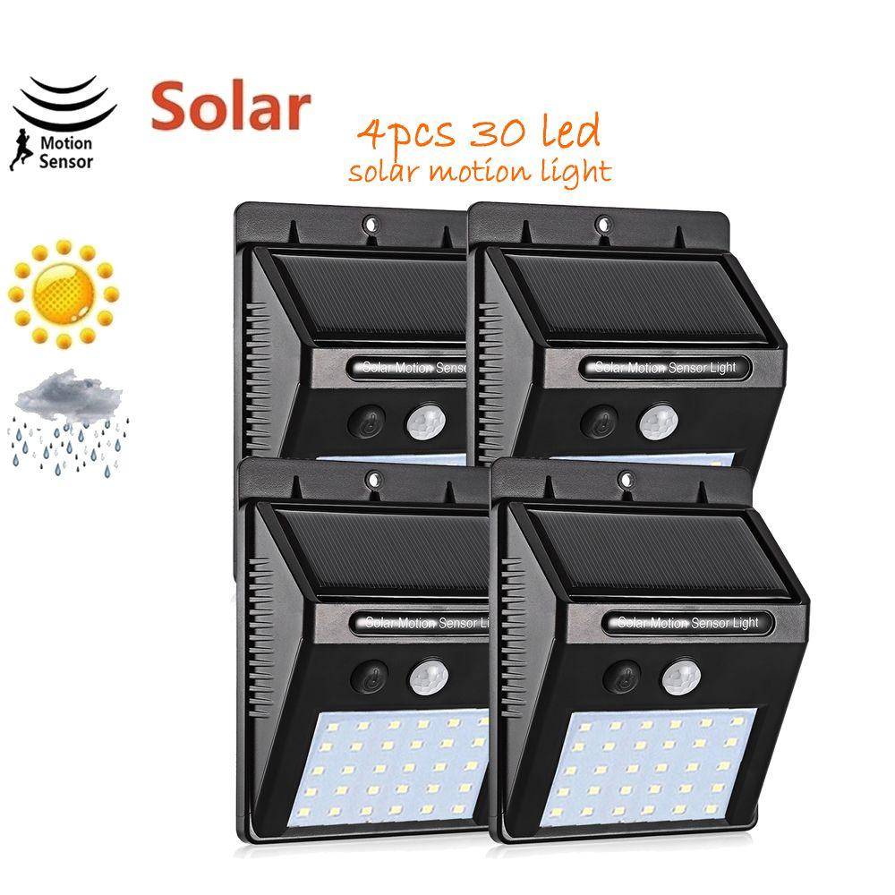4pcs LED Luz solar del sensor de movimiento al aire libre decoración del jardín de la luz de la cerca de la escalera cubierta de la luz del sol Camino Yard lámpara solar Seguridad