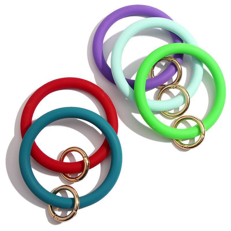 Porte-clés Charm Bracelets Bangles ronde Porte-clés Bague mode à la mode Femmes Sac Porte-clés Bijoux clés pour les clés de voiture en silicone Wristlet