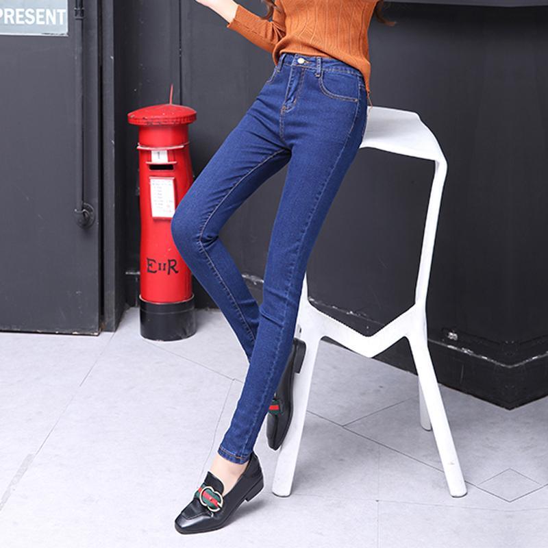 pantalón azul botón de signo más las mujeres del tamaño de los pantalones vaqueros de cintura alta pantalones negros pantalones de las mujeres altas elásticos flacos elásticos de tobillo