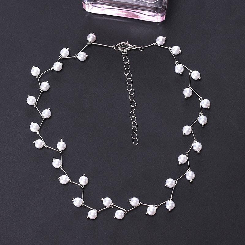 Neue süße Hübsche Trendy nachgemachte Perlen einfache kurze Kette Exquisite Claviclekettenhalskette für Frauen Mode-Hals-Zubehör