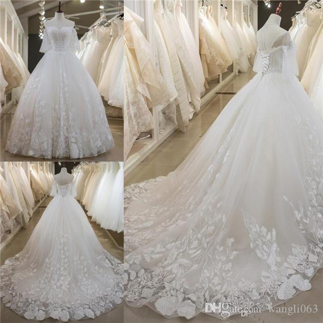 Latest Lace A Line Wedding Dresses 2019 Beaded Appliques Sexy Back With Lace-up Bridal Dresses Tiered Skirts Custom Made Wedding Gowns