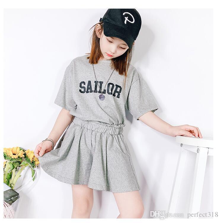 Nuovo design delle ragazze dei bambini set di moda patchwork fiori modello T-shirt + vestiti di pannello esterno vestiti per le ragazze di usura di estate