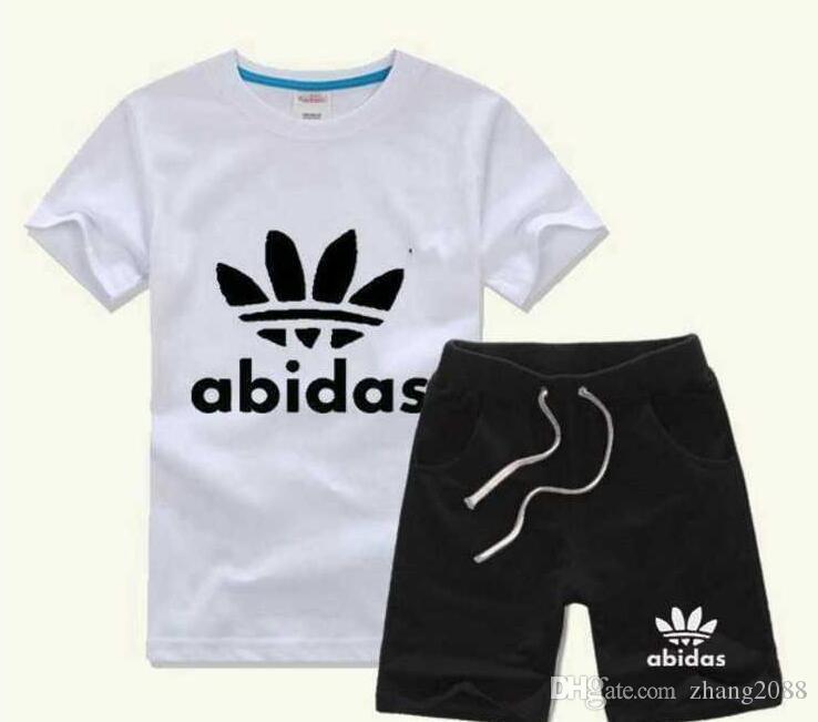 Горячее надувательство новая модная одежда роскошный логотип дизайнер мальчиков и девочек Спортивный костюм Baby младенческая с коротким рукавом Детская одежда Детский набор