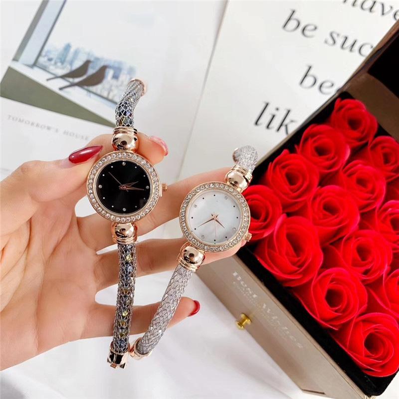 Marque populaire Mode femmes fille Cristaux colorés de style Bracelet bracelet en acier métal montre-bracelet à quartz Di 10