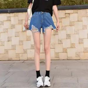 High-waisted super-short Women Xia Xianshou 2020 New South Korean version of white holes a word black wide-legged jeans fashion