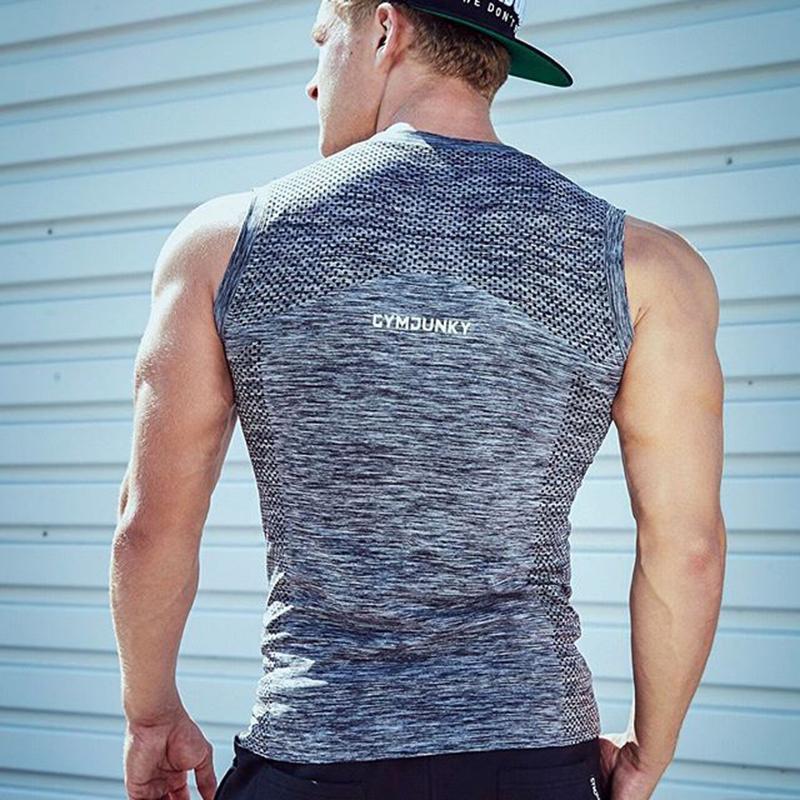 Hommes Gym Fitness muscles Formation d'été Nouveau sport respirant manches formation T-shirt de basket-ball serré séchage rapide Gilet