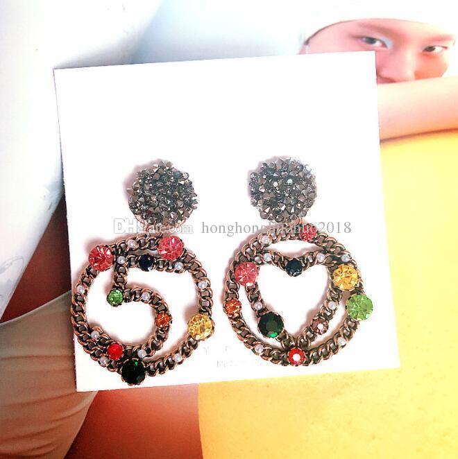Boucles d'oreilles asymétriques européennes et américaines strass Boucles d'oreilles 5 mot Boucles d'oreilles en argent pur femme pendentif couleur accessoires