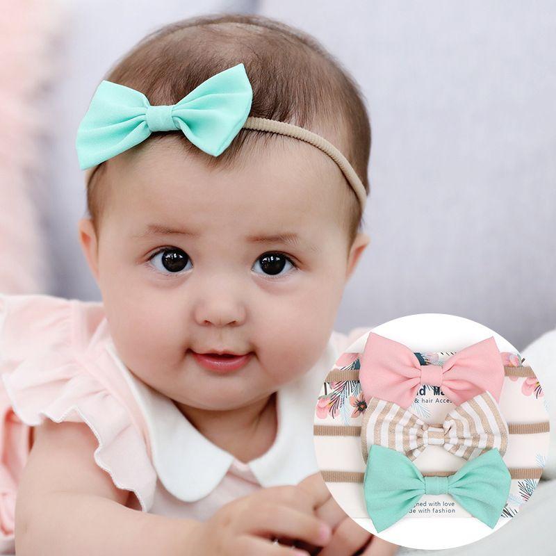 Европа Мода Младенец ребёнки Лук головная повязка Bowknot Cute Глава Упругие диапазона волос ободки банданы Hairbands A348