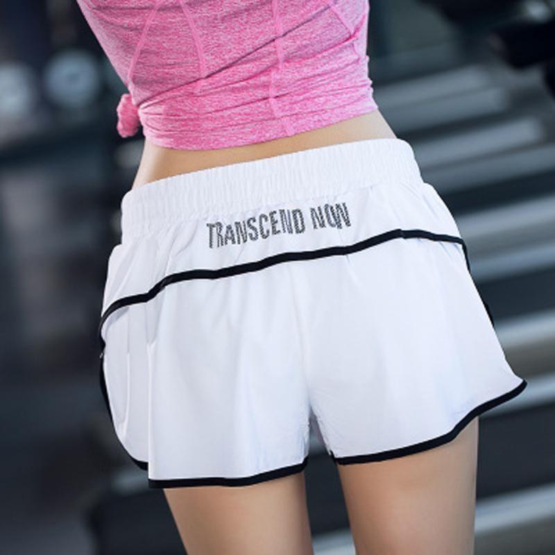Pantalones gimnasia Entrenamiento Fittness cortocircuitos muchacha de las mujeres Deportes Correr Fitness Workout sin fisuras Short Beach Casual cintura alta polainas