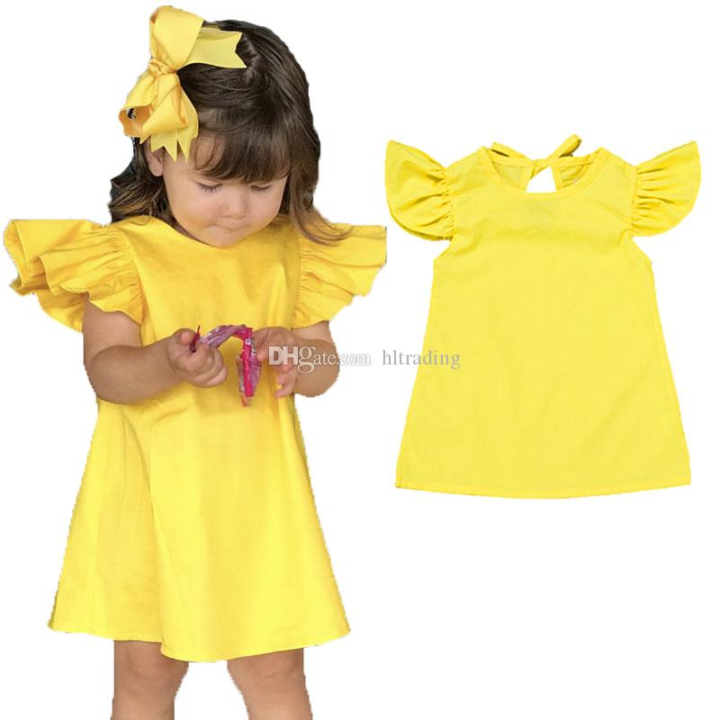 INS Neonate vestito giallo bambini Volare manica Bow principessa abiti 2019 estate Fashion boutique Abbigliamento bambini C5696