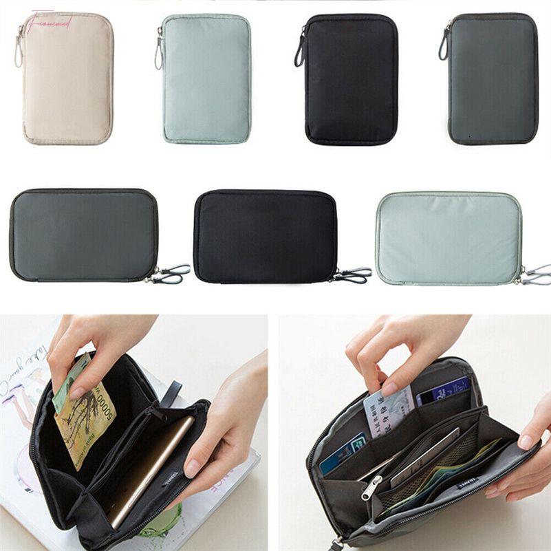 Femmes Hommes Nouveau Voyage Passport Wallet Porte-cartes Téléphone étanche document Case Casual Wallet Sac ordinaire argent massif