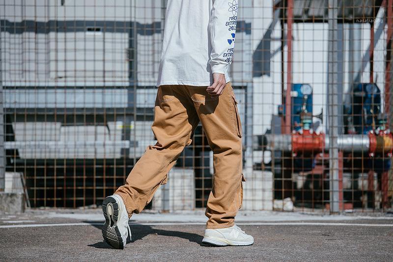 Grandes bolsillos de Hiphop del monopatín pantalones rectos flojos ocasionales para hombre primavera Nuevos pantalones de carga SS19