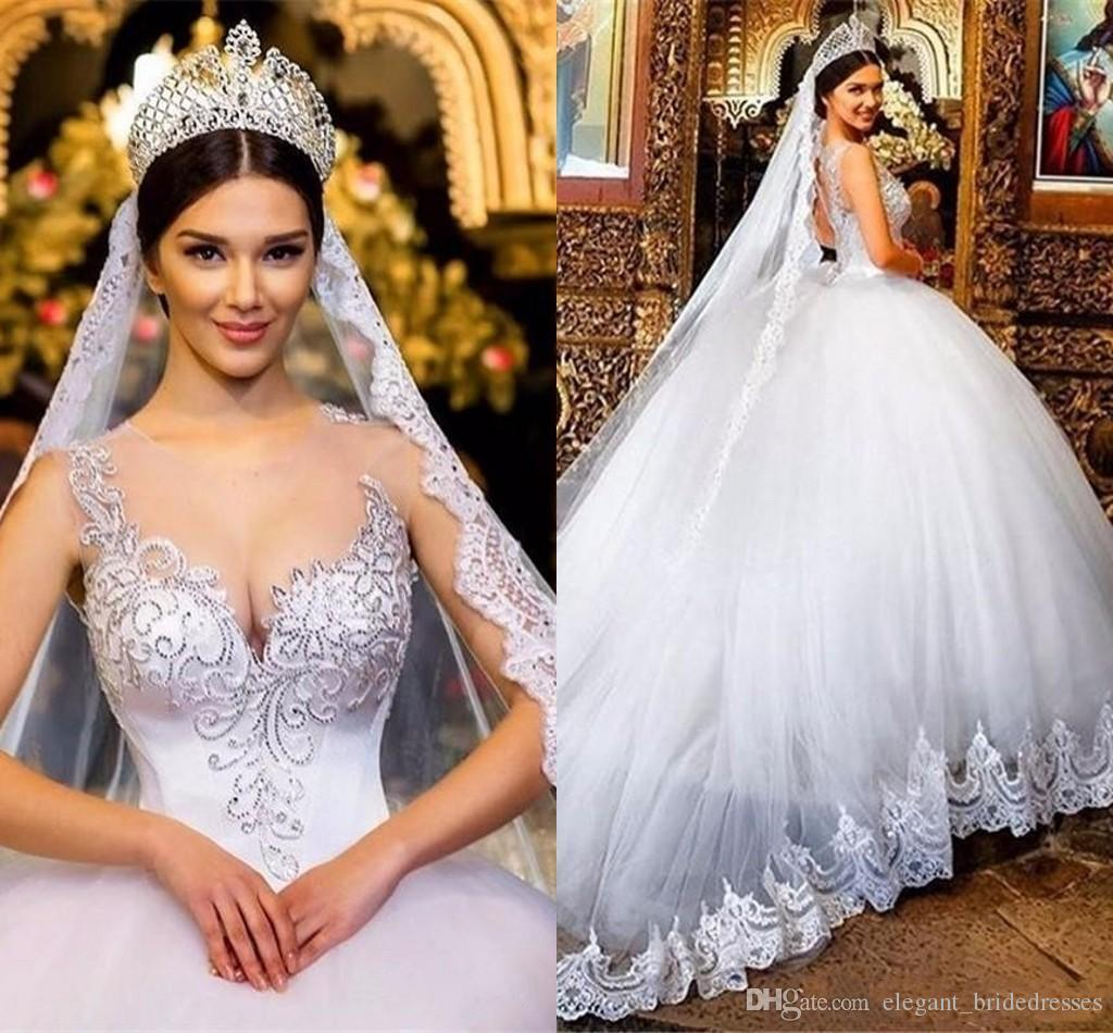 2018 Ball Gown Wedding Dresses Sheer Neckline Lace Applique Beads Crystal Sweetheart Hollow Back Court Back Plus Size Formal Bridal Gowns