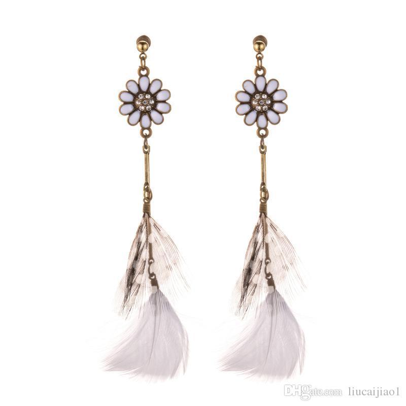 Supply sun flower feather earrings female European and American retro long exotic wind earrings