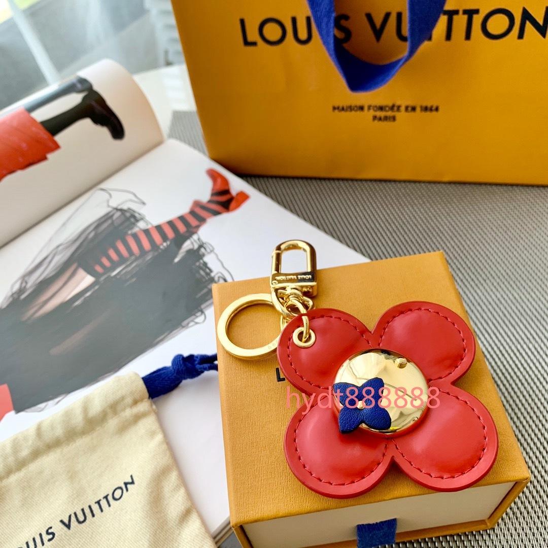 Con una caja de marca francesa de alta calidad llavero de lujo de estilo trébol de cuatro hojas para hombres y mujeres regalos clave de la cadena y recuerdos