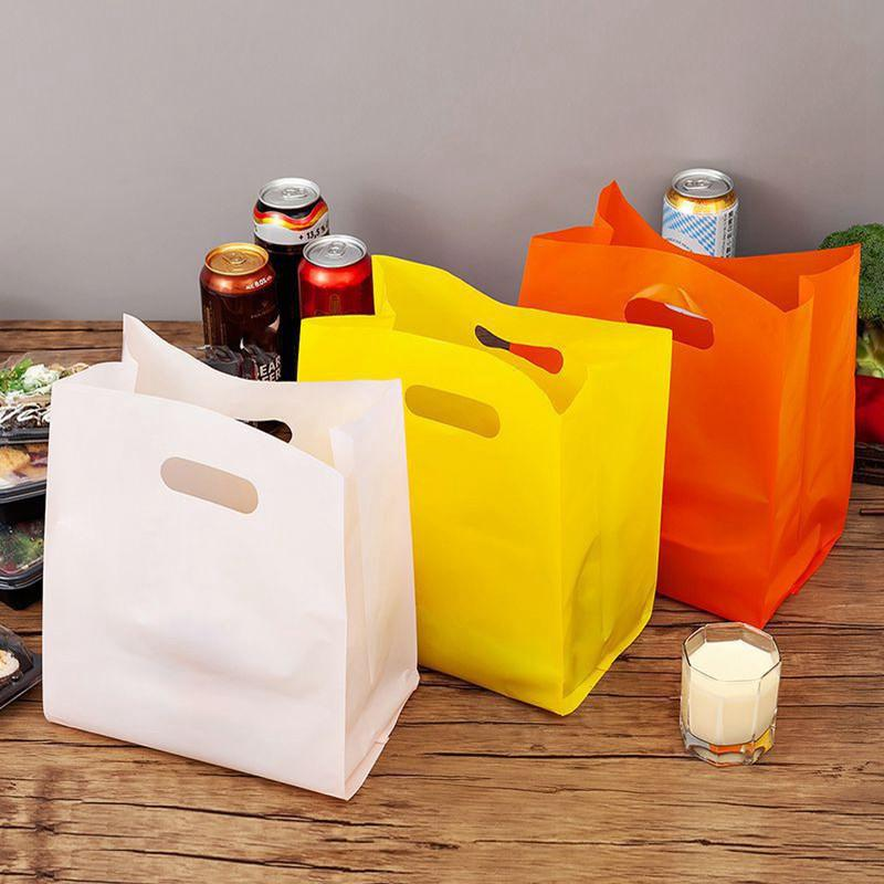 50pcs favor de partido Thicken Plastic laço Wedding Handle Bag roupa de plástico saco de transporte Adorável Obrigado presente Sacos