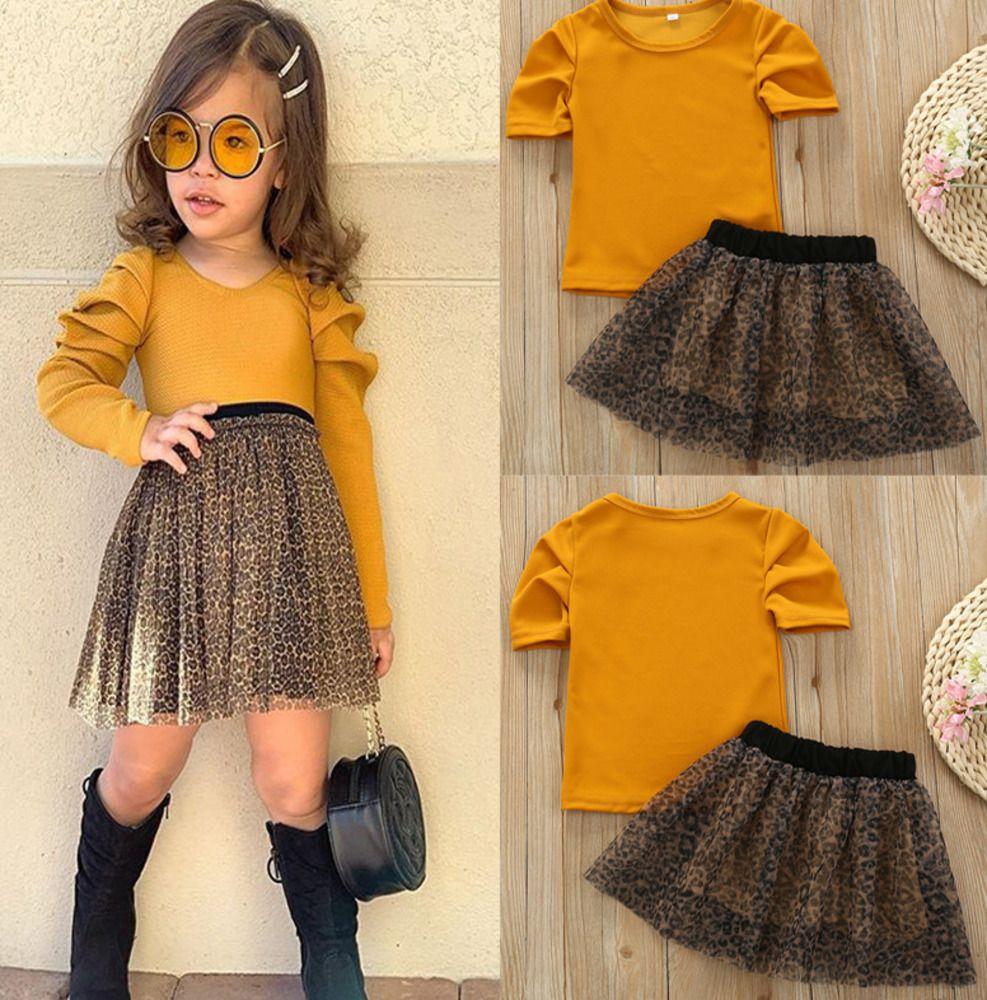 Девушка костюм желтый с коротким рукавом круглый воротник футболка леопардовый принт чистая пряжа короткая юбка из двух частей Набор детской одежды 0205