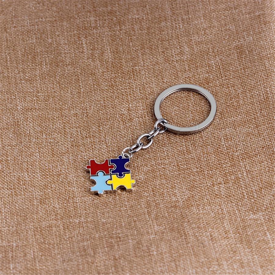 Autism creativo Jigsaw Key Chain 2019 nuovo Multi-Colored Drip Oil Puzzle Car Clasp Catena chiave Articoli novità Ornamenti Regali di partito
