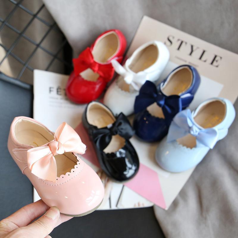 Zapatillas de deporte clásico del bebé recién nacido los primeros caminante del niño del niño infantil para niños de los bebés nudo de la mariposa de la princesa zapatos de cuero