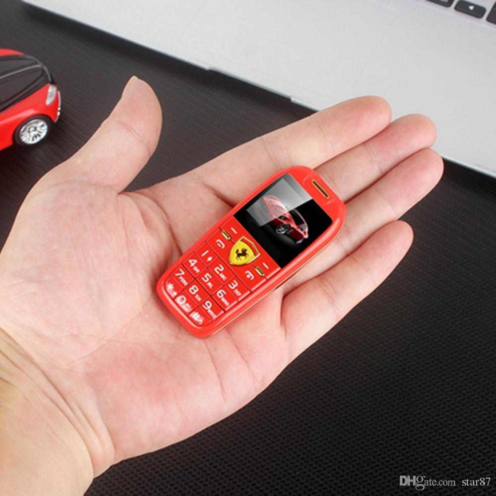 "Mini Car Key Push Button Telephone 1.0"" Hands Cartoon Kids Mobile Phone Magic Voice MP3 Bluetooth Dialer Cheap Straight Toys Car CellPhone"