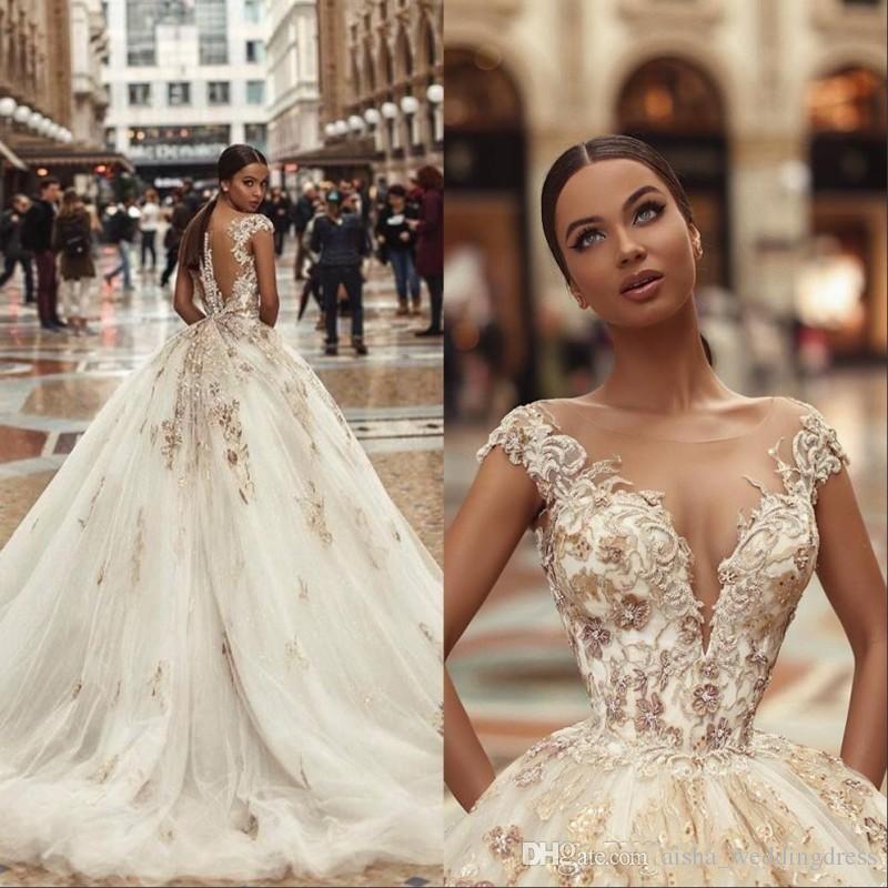 Encaje africano Grano Vestidos de novia Sheer cuello Ilusión Manga capsulada Sirena Vestidos de novia con botones de espalda cubiertos Vestido de novia