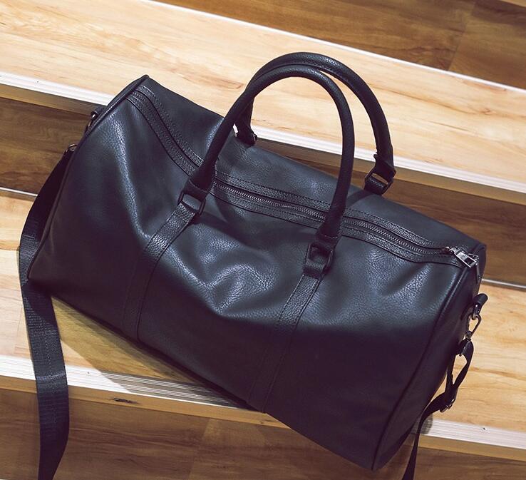 Diseñador de 60cm de gran capacidad mujeres bolsas de viaje clásico de la venta caliente de alta calidad de los hombres de hombro Bolsos de tela equipaje de mano