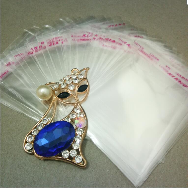 Hot Sale 7cmx12cm OPP Transparent Jewelry package Bag Self Adhesive Seal Plastic Bags Clear Cellophane Bag Gift package Bag