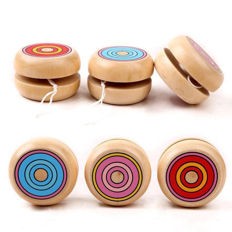 Color de la mezcla al por mayor 10 piezas de Spin magia de los niños Yoyo Cadena bola redonda profesionales juguetes de madera para los niños