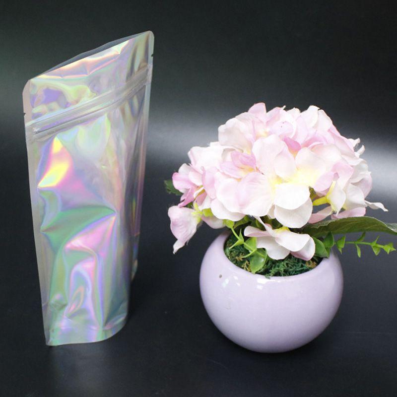 Neue Ankunft Haustier Holographisches Zubehör Lager Farbe Flache Reißverschluss Taschen Laser Mylar Pouch Wiederverwendbare Aluminiumfolie Food Safe Taschen