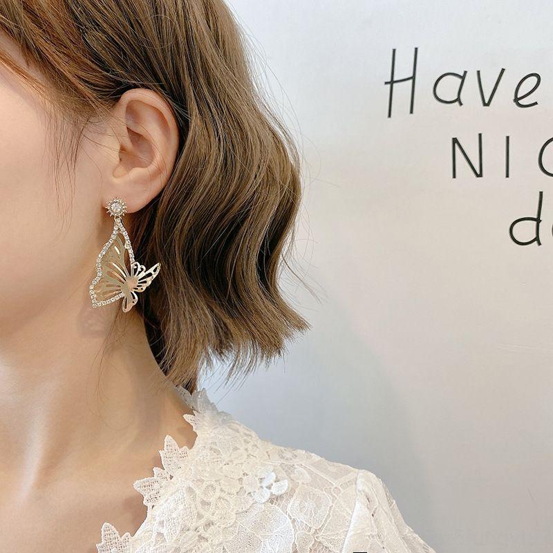 brincos novos coreano borboleta assimétrica e brincos das mulheres borboleta moda Dongdaemun moda ins brincos metálicos 2020 2Yp3u