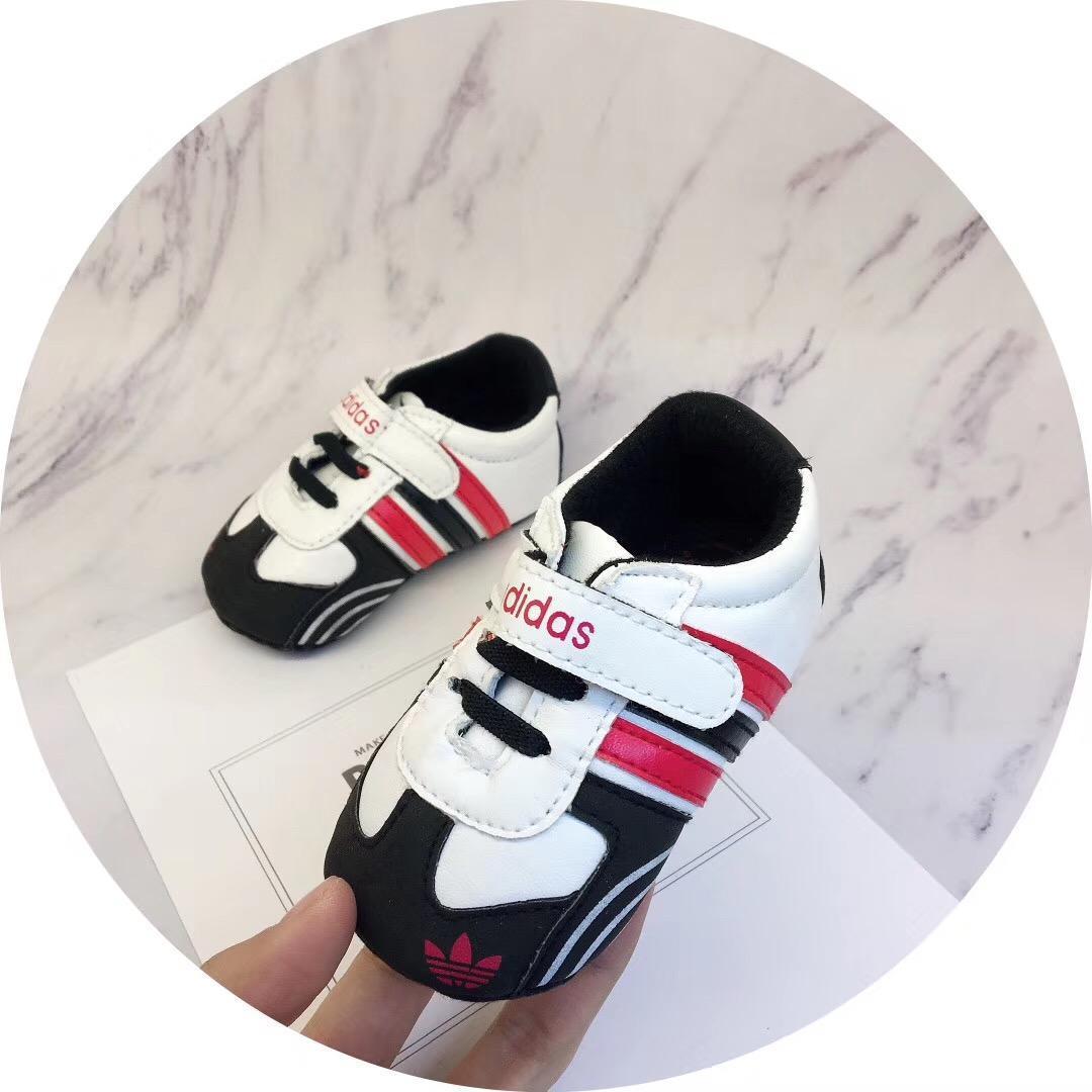 Nueva Primavera Moda Niño Primer caminante Zapatos de bebé Zapatos para niños Zapatillas Prewalker Zapatillas de lona Kawaii Zapatos