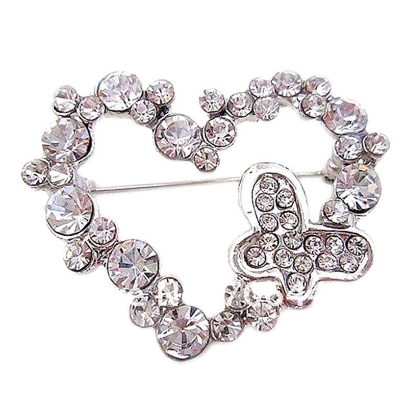 Mooie zilveren kleur vlinder en hart kristal broche