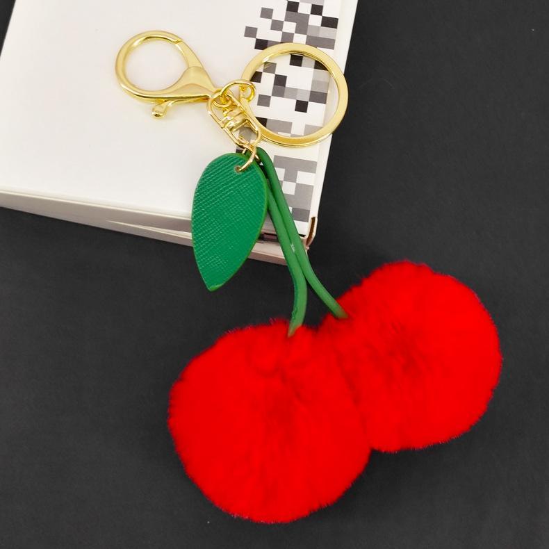 원래 새로운 귀여운 가짜 모피 공을 응원 체리 키 체인 무성한 자란 키 체인 폼은 폼은 장난감 열쇠 고리 가방 매력 자동차 악세사리