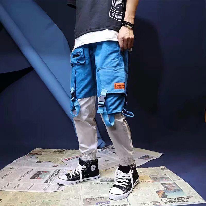Pantalones de carga varones sueltos Hip hop Streetwear Joggers Corea del bolsillo de remiendo Harem altura del tobillo pantalones Techwear CY200518